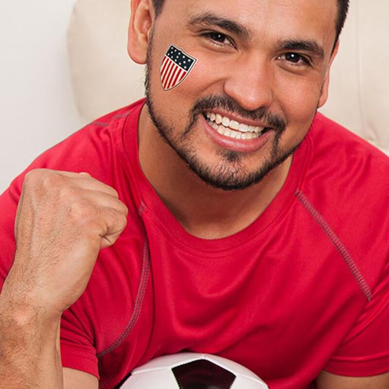 man wearing team usa shield tattoo on face image number null