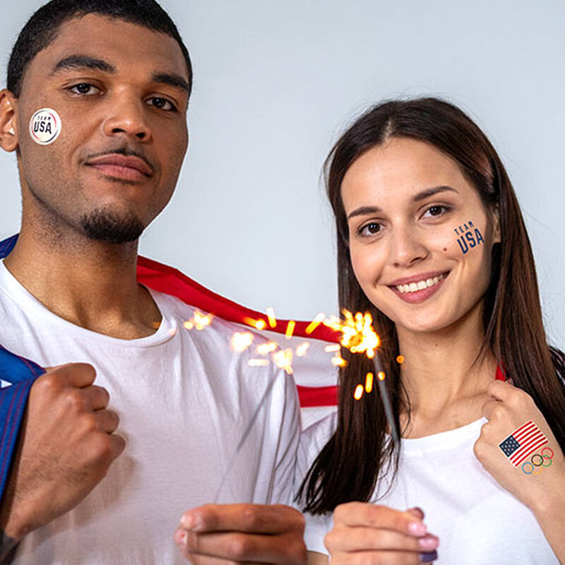 man and woman wearing team usa tattoos image number null