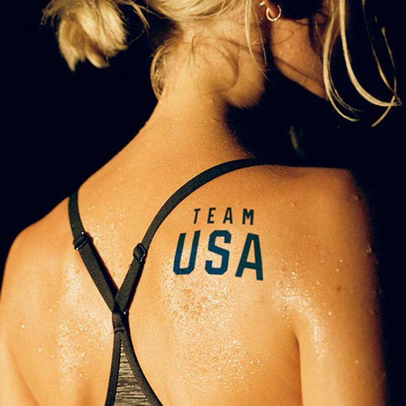 woman wearing team usa blue logo tattoo on back image number null