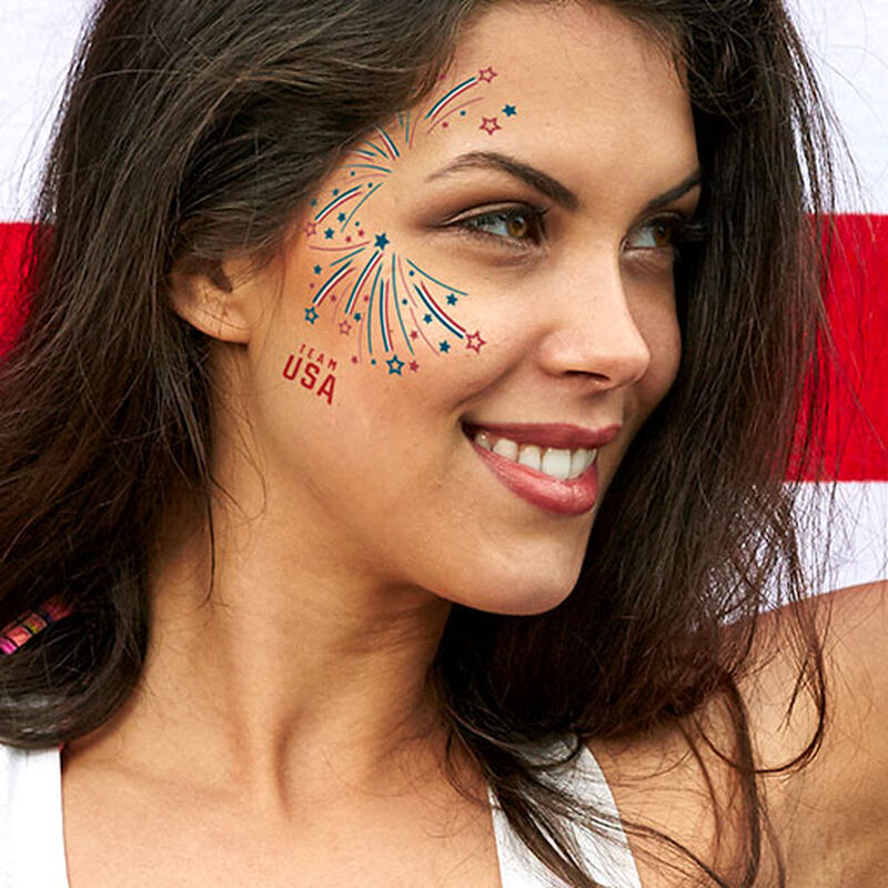woman wearing team usa fireworks tattoo on cheek image number null