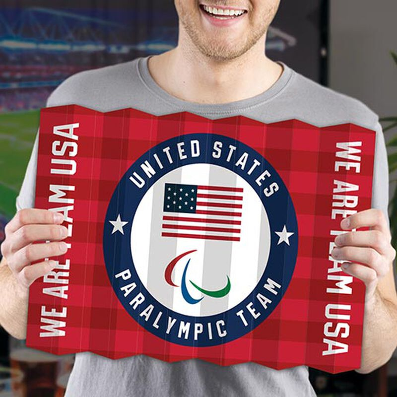 man holding paralympic team usa fan banner image number null