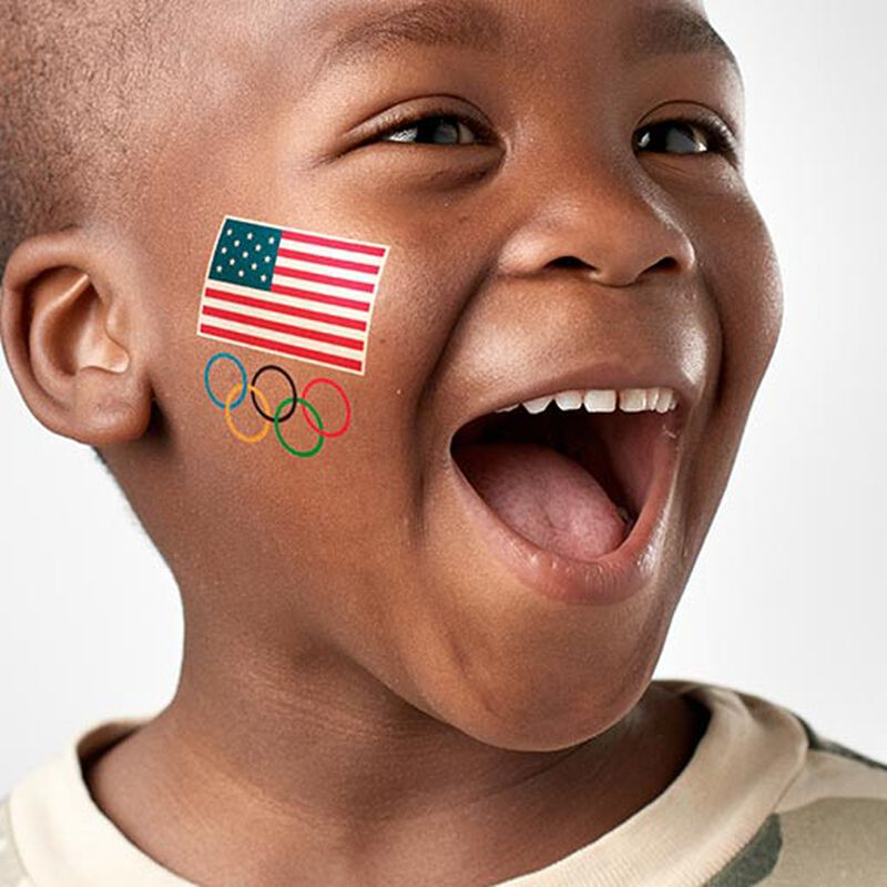 boy wearing team usa olympics tattoo on face image number null