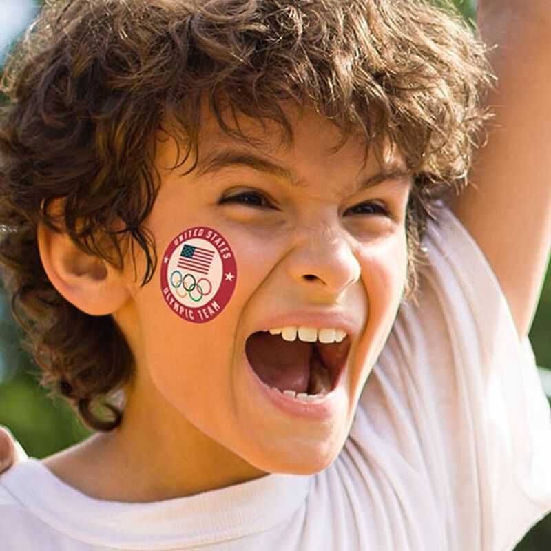 boy wearing us olympic team seal tattoo on cheek image number null