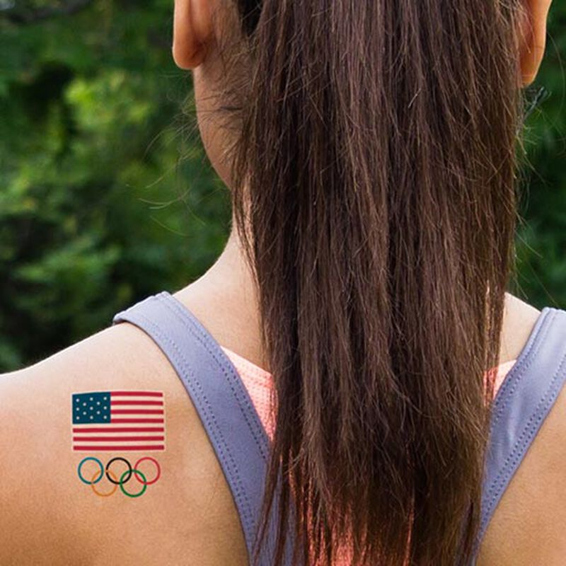 woman wearing team usa olympics tattoo on shoulder blade image number null